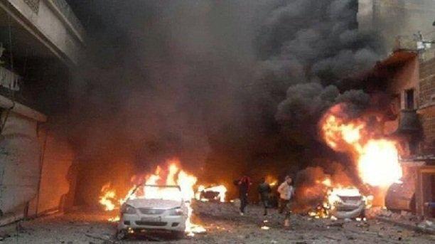 عشرات القتلى بانفجارين بحي الزهراء في حمص