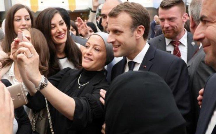 ماكرون: أحترم كل امرأة ترتدي الحجاب